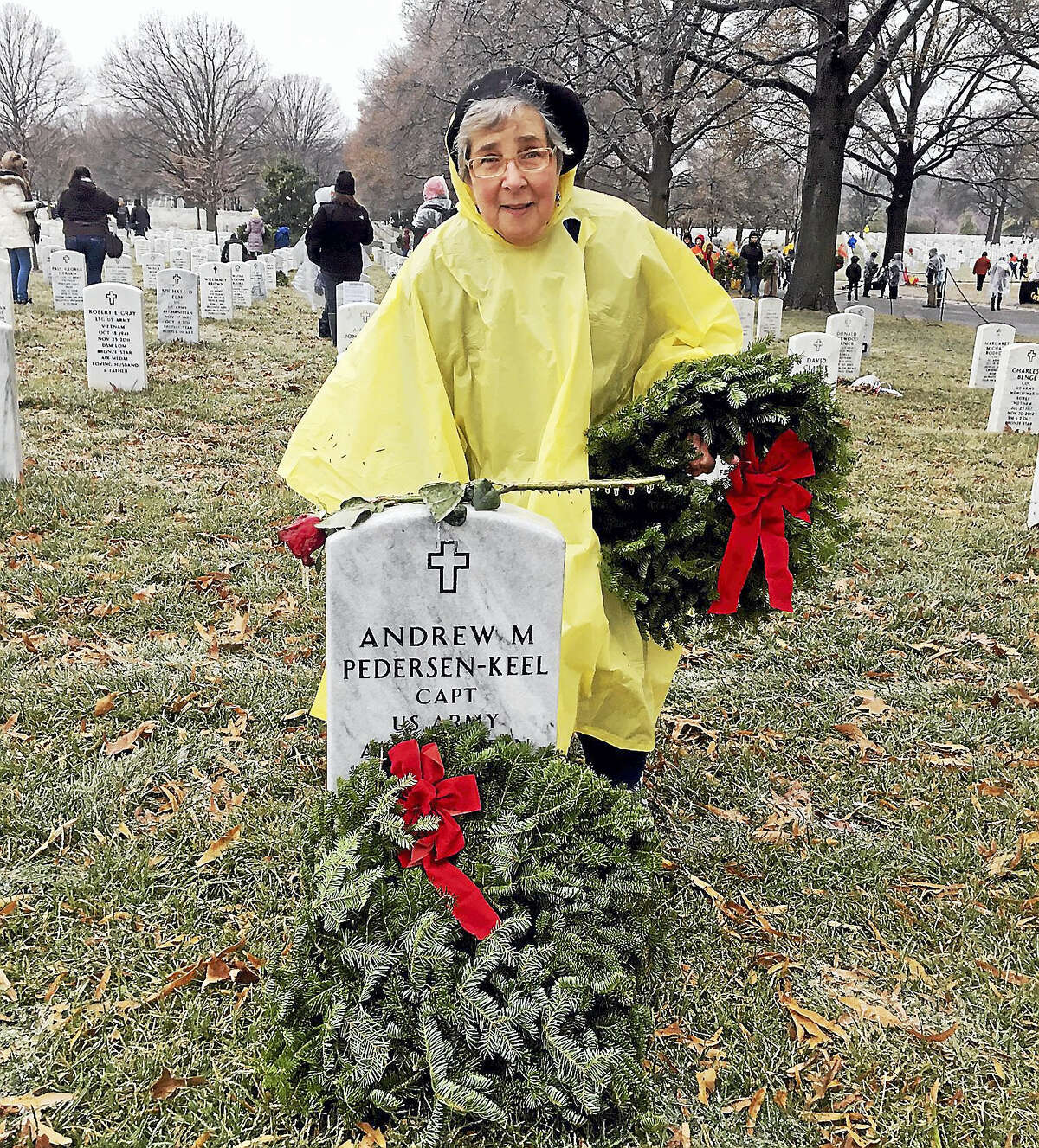 Branford's Barbara Racette, a Blue Star Mother, at the grave of Army Capt. Andrew Pedersen-Keel of Madison.