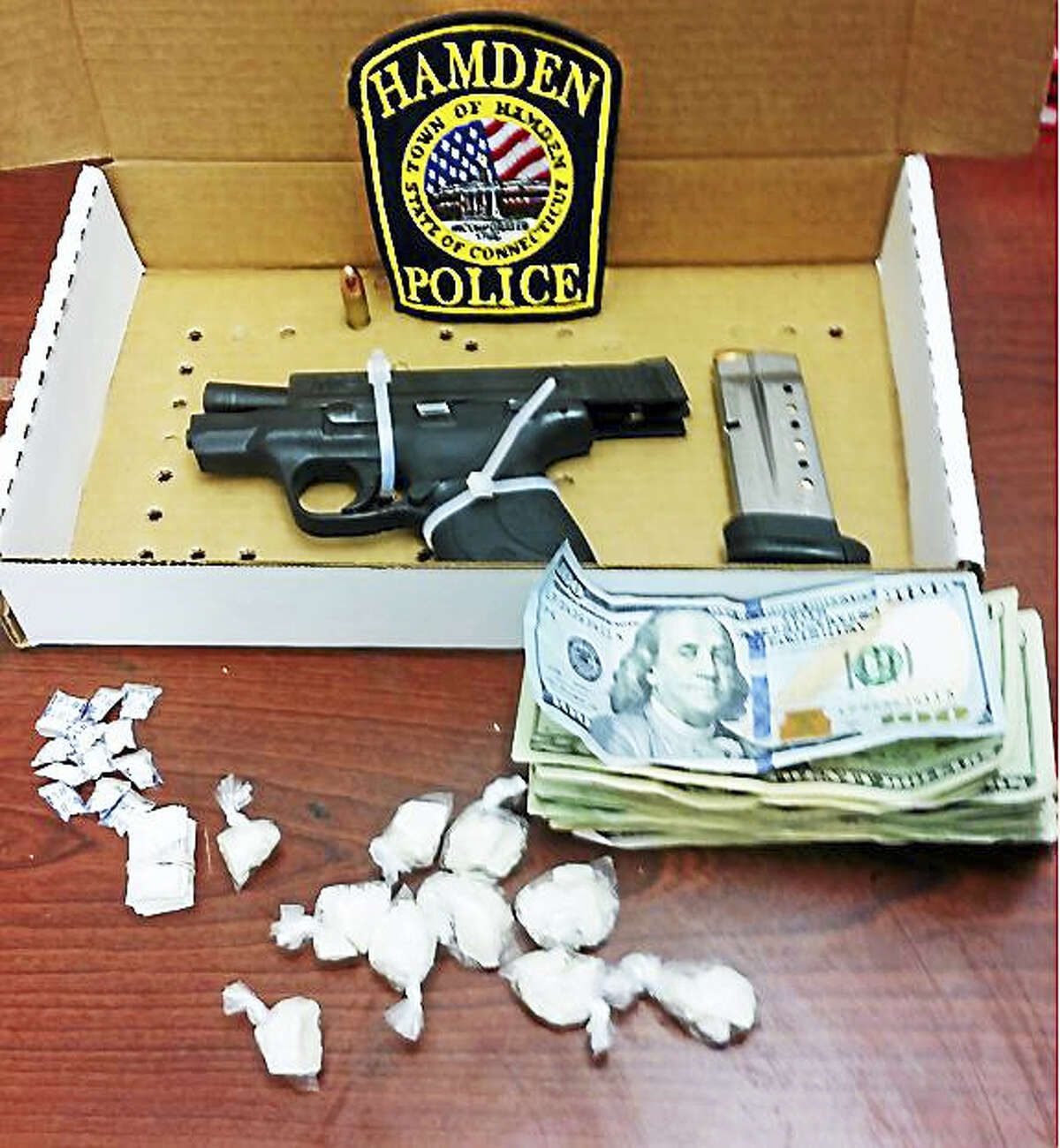 Police say this stolen weapon, along with 23 bags of crack cocaine and 10 folds of heroin, were recovered after they arrested Johnny Stroud III on New Year's Eve in Hamden.
