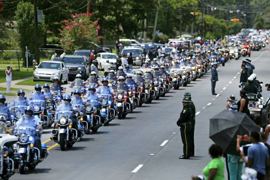 FILE - In this July 25, 2016 file photo, the funeral procession for slain Baton Rouge police Corporal Montrell Jackson leaves the Living Faith Christian Center in Baton Rouge, La. Jackson, slain by a gunman who authorities said targeted law enforcement. The number of police killed in the line of duty rose sharply in 2016, driven by shootings of police around the country, most notably ambushes in Dallas and Baton Rouge, Louisiana. From Jan. 1 through Wednesday, 135 officers lost their lives. Some died in traffic accidents, but nearly half were shot to death. Photo: AP Photo/Gerald Herbert, File / Copyright 2016 The Associated Press. All rights reserved. This material may not be published, broadcast, rewritten or redistribu