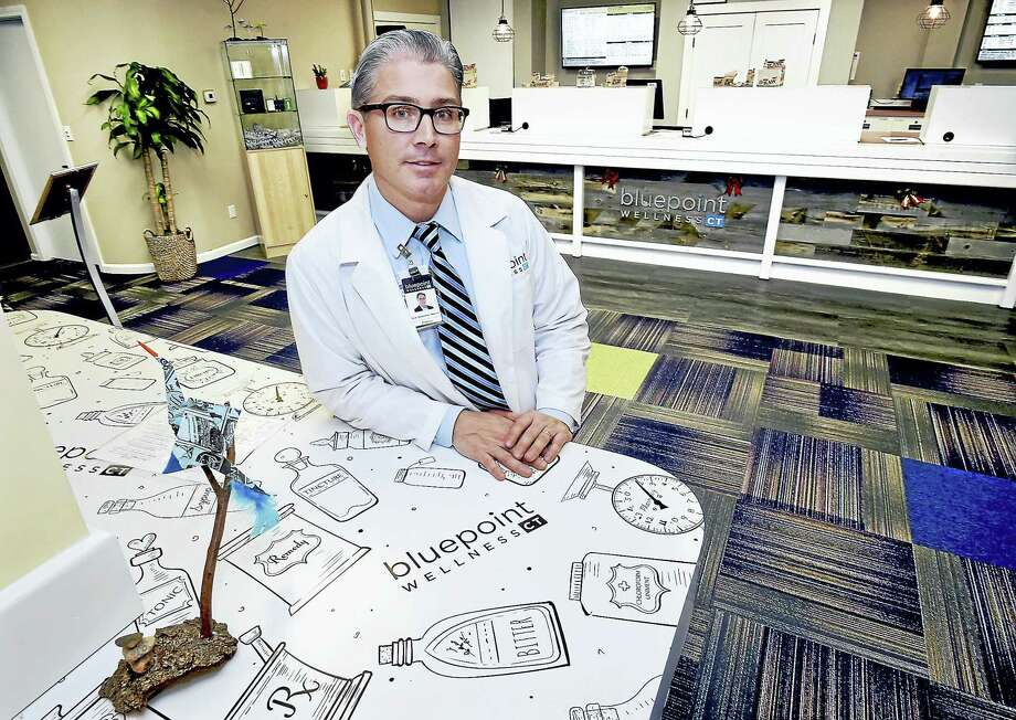 Pharmacist Nicholas Tamborrino, owner of Bluepoint Wellness of Connecticut, one of eight medical marijuana dispensaries in the state. Photo: Catherine Avalone — New Haven Register    / New Haven RegisterThe Middletown Press