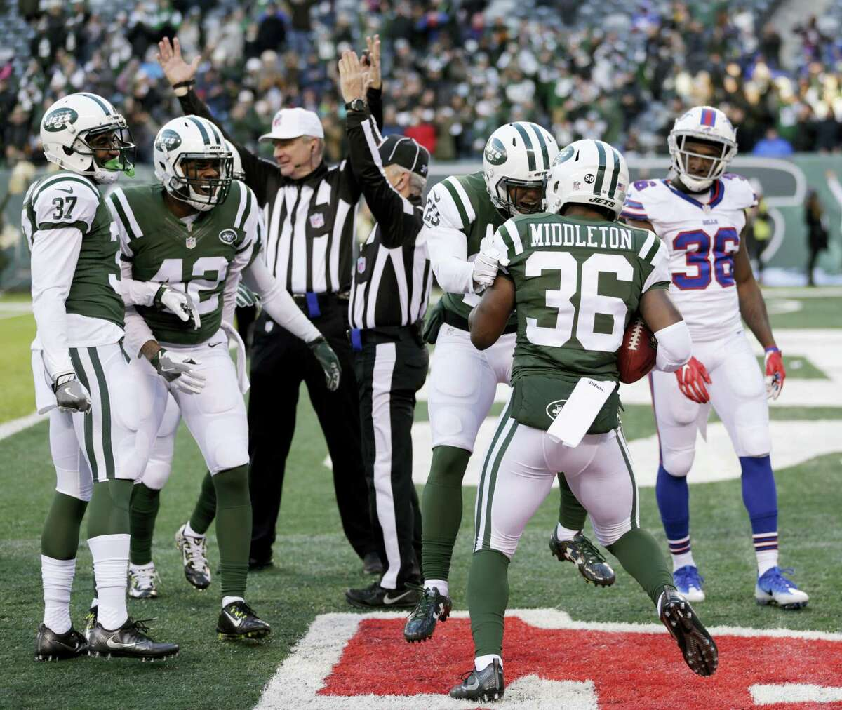Jets defensive back Doug Middleton (36) is congratulated after scoring a touchdown by recovering a kickoff in the Bills end zone on Sunday.