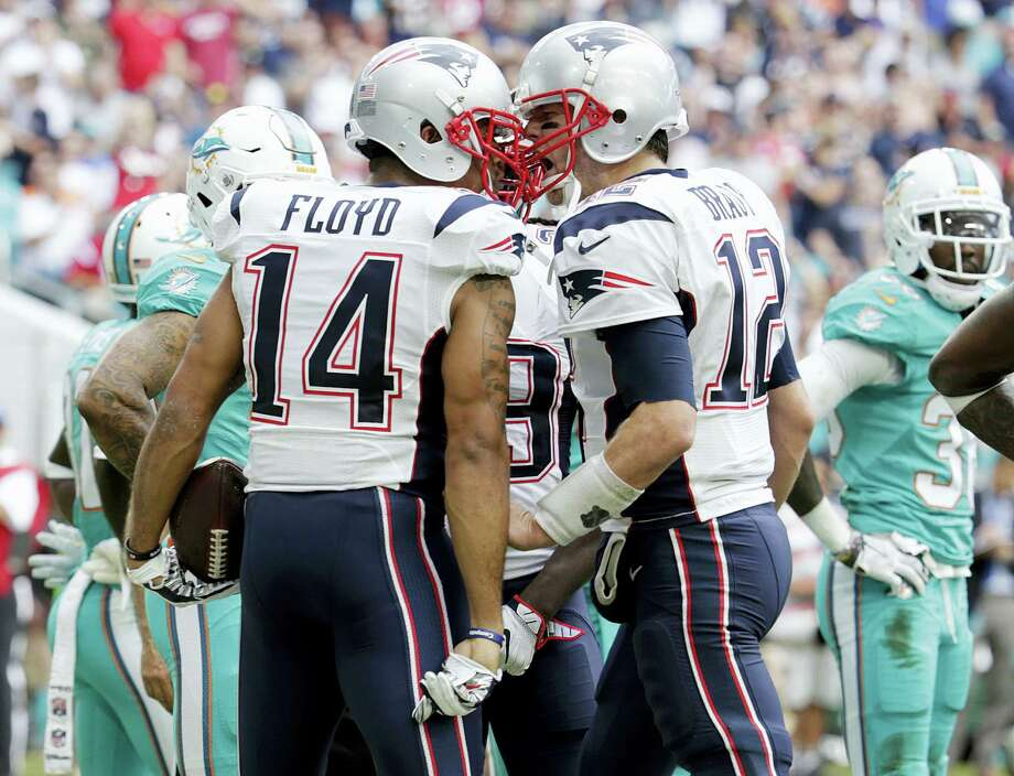Patriots quarterback Tom Brady (12) congratulates wide receiver Michael Floyd after Floyd scored a touchdown in the first half on Sunday. Photo: Lynne Sladky — The Associated Press   / Copyright 2017 The Associated Press. All rights reserved.
