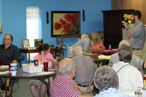 Wallace Scot McFarlane of Columbia University gives a presentation on the history of the Trinity River at the Coldspring Senior Center on July 20. McFarlane's presentation is part of his path to writing his dissertation as he is a current candidate for a PhD.