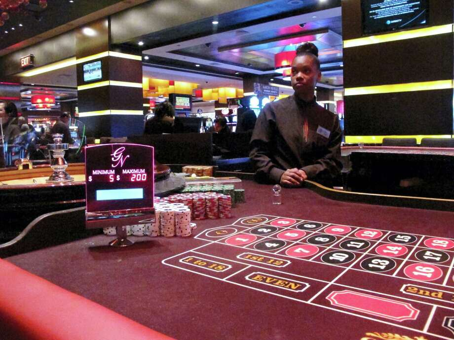 A dealer waits for customers at a roulette table at the Golden Nugget casino in Atlantic City, N.J. Whether the city's seven casinos will see their finances stabilize and post a revenue increase for the first time in a decade is one of the major questions facing Atlantic City in 2017. Photo: Wayne Parry — AP File Photo / Copyright 2016 The Associated Press. All rights reserved.