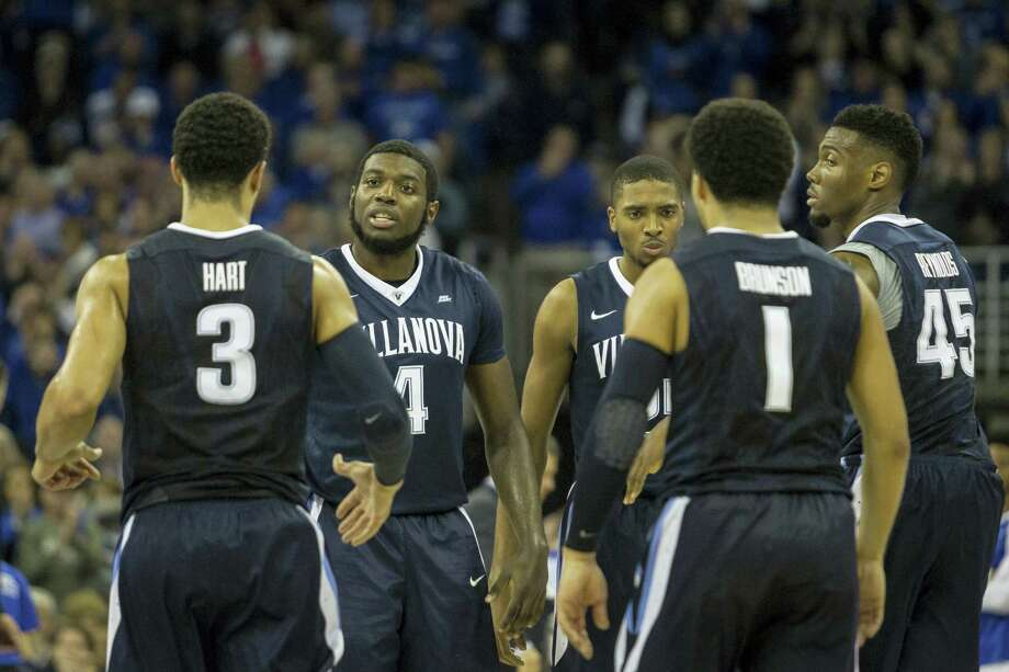 Villanova forward Eric Paschall (4) talks with his teammates during Saturday's game against Creighton. Photo: The Associated Press    / AP