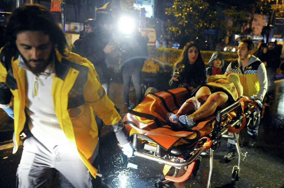 Medics carry a wounded person at the scene after an attack at a popular nightclub in Istanbul, early Sunday. Istanbul Governor Vasip Sahin said that an armed assailant has opened fire at a nightclub in Istanbul during New Year's celebrations. Turkish authorities have banned distribution of images relating to the Istanbul attack within Turkey. Photo: IHA Via AP   / IHA