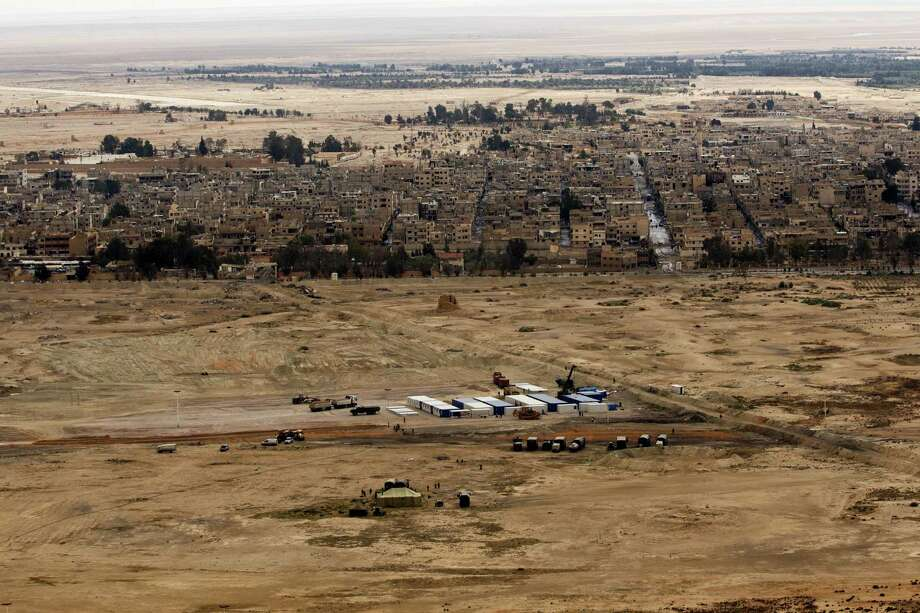 In this file photo, a Russian military camp is seen at the ancient city of Palmyra in the central city of Homs, Syria. U.S.-Russian talks on their separate fights against the Islamic State group are improving and becoming more frequent, American officials said. In the discussions, Russia has made clear its counterterrorism priority in Syria is retaking the ancient city of Palmyra, officials said. Photo: Hassan Ammar — The Associated Press File   / Copyright 2016 The Associated Press. All rights reserved. This material may not be published, broadcast, rewritten or redistribu