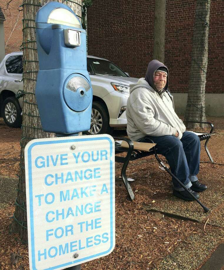 In this Dec. 27, 2016 photo, Joe Drury, who said he is homeless, sits near a parking-style meter in Annapolis, Md., used to collect loose change from those who might otherwise give money to those begging on the street. Drury said the meters may help charities, but they do nothing for him. The first of the meters designed to help the homeless went up in Denver in 2007 and dozens of other cities have followed suit. Photo: AP Photo — Pat Eaton-Robb / Copyright 2016 The Associated Press. All rights reserved.