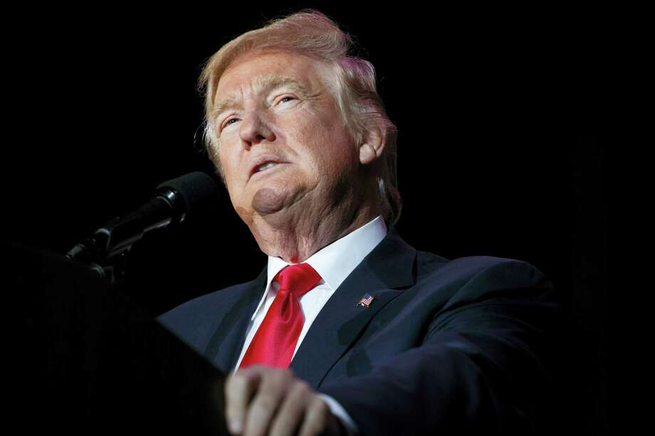 In this file photo, President-elect Donald Trump speaks during a rally in Orlando, Fla. Photo: Evan Vucci — The Associated Press File   / Copyright 2016 The Associated Press. All rights reserved.