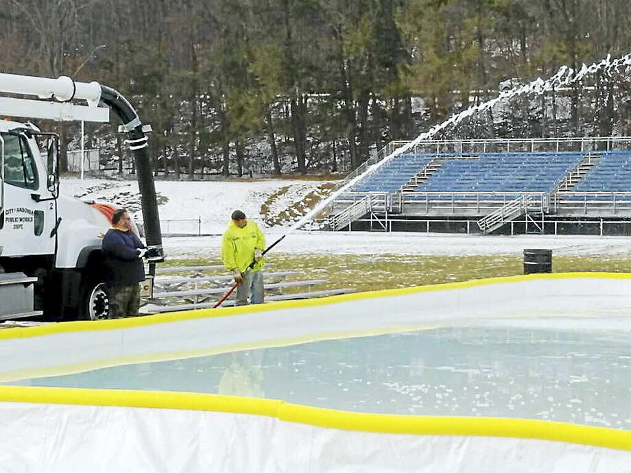 Public Works employees fill the ice rink with 14,000 gallons of water. Photo: Photo - Public Works Superintendent Mike D'Alessio