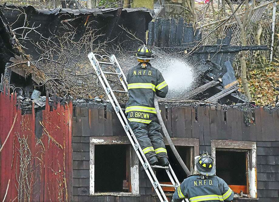 New Haven firefighters at the scene of a fire at a shed located behind a rental duplex home at 259 Quinnipiac Ave. in the Fair Haven Heights section of New Haven, Wednesday. Photo: Catherine Avalone — New Haven Register / New Haven RegisterThe Middletown Press
