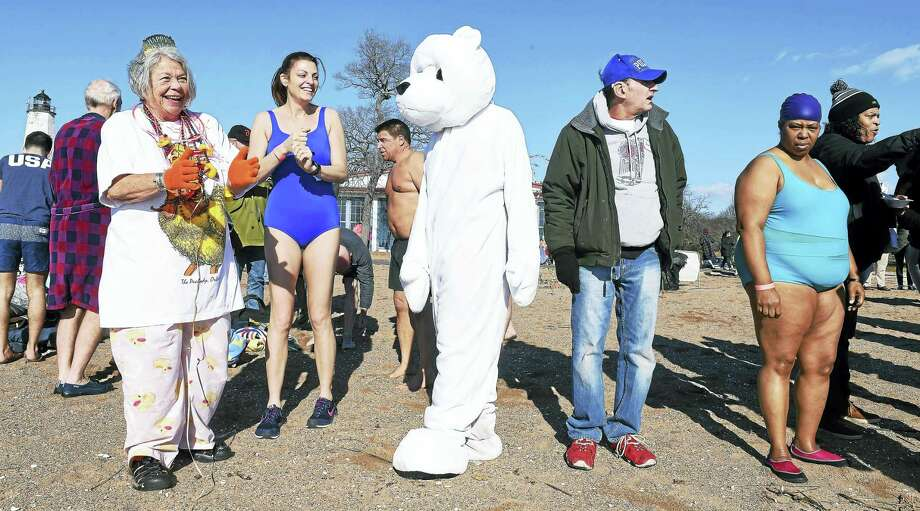 Participants prepare to run into the Long Island Sound at the 15th Annual Plunge for the Parks. Photo: Arnold Gold-New Haven Register
