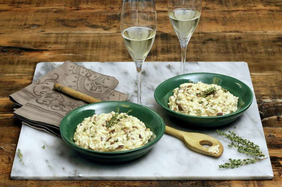 Champagne risotto is a festive, hot dish on a cold New Year's Eve. Photo: Richard Drew — The Associated Press   / AP