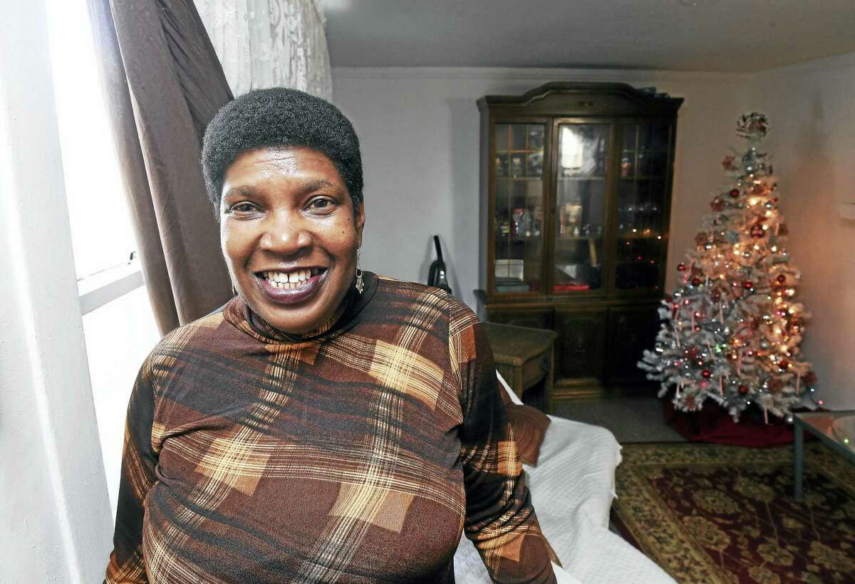 Jo-Ann Ndiaye is in the living room of her home in New Haven where she has lived for 12 years.