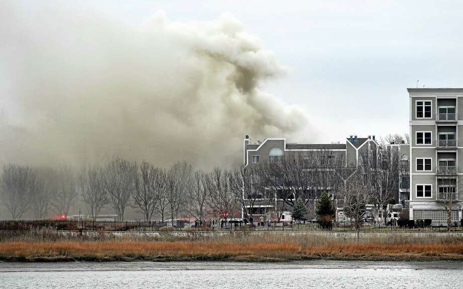 New Haven Fire Department battles blaze on Harbour Close in New Haven on Monday. Photo: Arnold Gold — New Haven Register