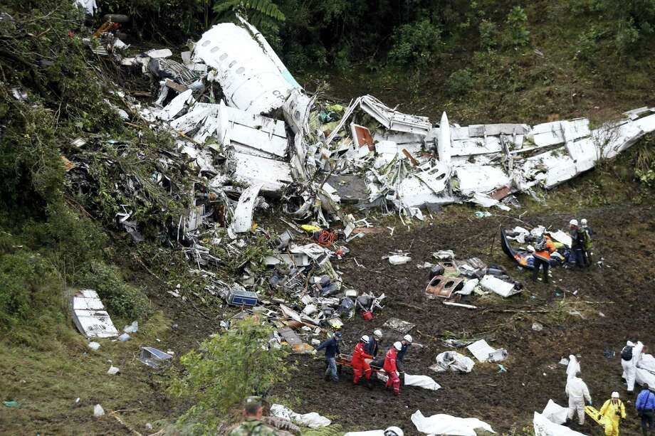 Rescue workers recover a body from the wreckage site of an airplane crash, in La Union, a mountainous area near Medellin, Colombia, Tuesday, Nov. 29, 2016. The plane was carrying the Brazilian first division soccer club Chapecoense team that was on it's way for a Copa Sudamericana final match against Colombia's Atletico Nacional. Photo: Fernando Vergara — AP Photo / Copyright 2016 The Associated Press. All rights reserved.