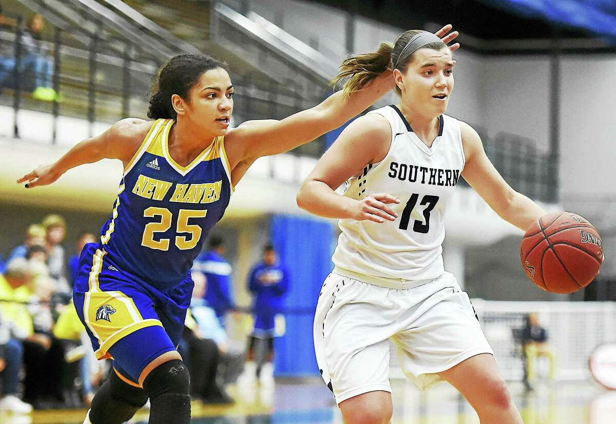 SCSU senior guard Maria Weselyj drives to the hoop for two as UNH sophomore guard Alexandria Kerr defends, Wednesday at the Moore Field House at Southern Connecticut State University. The Owls won, 79-54.s