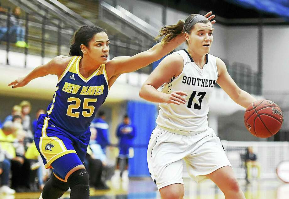 SCSU senior guard Maria Weselyj drives to the hoop for two as UNH sophomore guard Alexandria Kerr defends, Wednesday  at the Moore Field House at Southern Connecticut State University. The Owls won, 79-54.s Photo: CATHERINE AVALONE — NEW HAVEN REGISTER   / New Haven RegisterThe Middletown Press