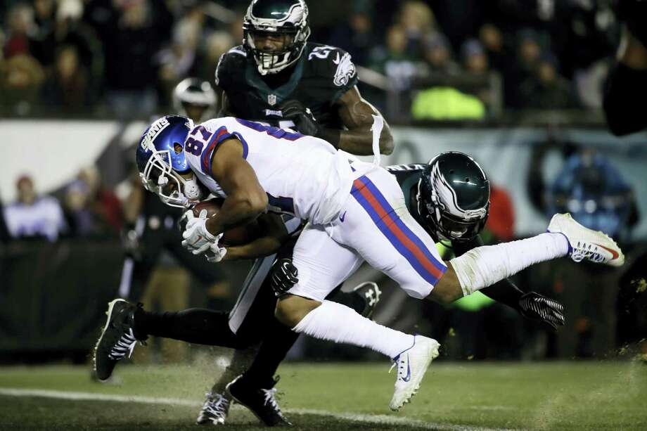 New York Giants' Sterling Shepard (87) scores a touchdown against Philadelphia Eagles' Jaylen Watkins (26) during the first half of an NFL football game Dec. 22, 2016 in Philadelphia. Photo: AP Photo/Matt Rourke   / Copyright 2016 The Associated Press. All rights reserved.