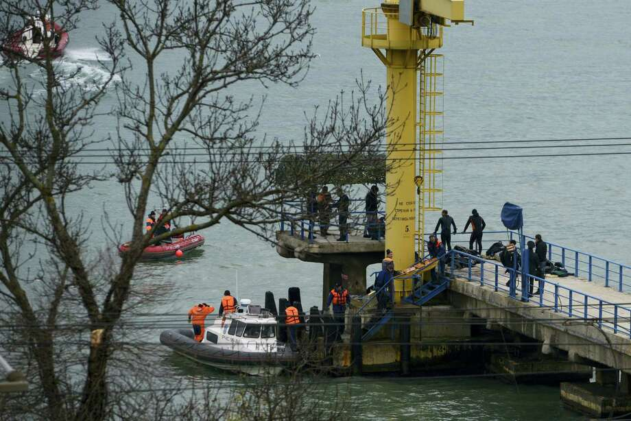 Russian rescue workers collect wreckage from the crashed plane at a pier just outside Sochi, Russia on Dec. 25, 2016. Russian ships, helicopters and drones are searching for bodies after a plane carrying 93 people crashed into the Black Sea. The plane was taking the Alexandrov Ensemble, a military choir, to perform at Russia's air base in Syria when it went down shortly after takeoff. Photo: AP Photo/Viktor Klyushin   / Copyright 2016 The Associated Press. All rights reserved.