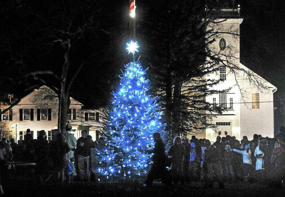 The Orange Christmas tree is lit on the Green during the annual tree lighting ceremony, Dec. 8, 2013. Photo: . Peter Casolino/new Haven Register