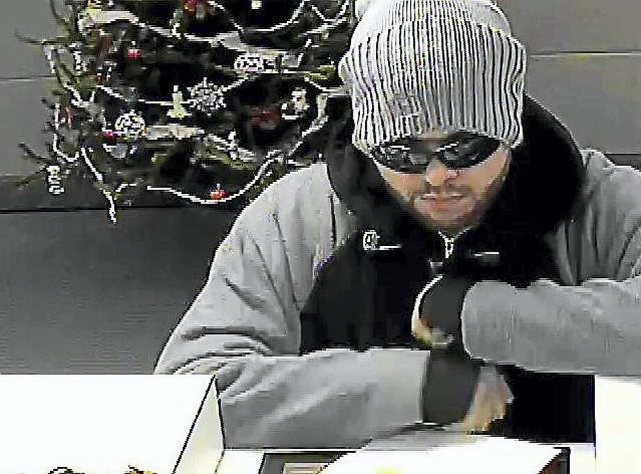Milford police are looking for this man who allegedly robbed a Webster Bank branch in the Woodmont neighborhood late Wednesday morning. A $500 reward is being offered for information leading to his arrest. Photo: Courtesy Of Milford Police Department
