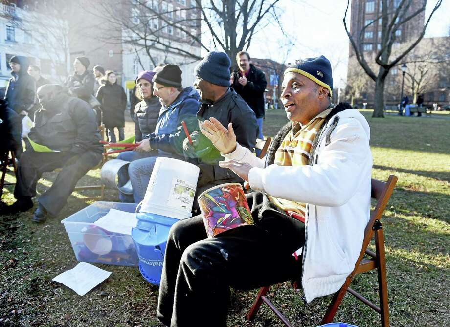 (Arnold Gold-New Haven Register)  Tyrone White (right) joins a contingent of drummers during a Chapel on the Green Christmas service behind Trinity Church on the Green in New Haven on 12/25/2016. Photo: Digital First Media