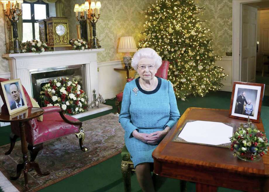 In this photo released Dec. 25, 2016 Britain's Queen Elizabeth II poses for a photo, sitting at a desk in the Regency Room of Buckingham Palace in London, after recording her traditional Christmas Day broadcast to the Commonwealth. Queen Elizabeth prerecords her traditional Christmas Day festive speech to be broadcast to the British Commonwealth nations on Christmas Day. Photo: Yui Mok / Pool Via AP   / pool PA