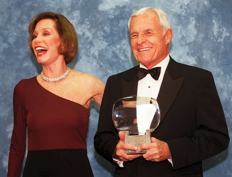 """In this Saturday, Nov. 1, 1997, file photo, Television executive Grant Tinker holds up his Hall of Fame award alongside his ex-wife Mary Tyler Moore at the Academy of Television Arts & Sciences' 13th Annual Hall of Fame induction ceremonies in the North Hollywood section of Los Angeles. Tinker, who brought """"The Mary Tyler Moore Show"""" and other hits to the screen as a producer and a network boss, has died. Tinker died Monday, Nov. 28, 2016, at his home in Los Angeles, according to his son, Mark Tinker. Photo: Chris Pizzello — AP File Photo   / AP1997"""