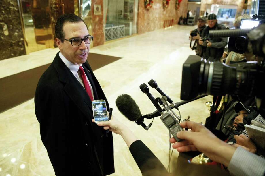Steven Mnuchin, President-elect Donald Trump's nominee for Treasury Secretary, talks with reporters in the lobby of Trump Tower, Wednesday, Nov. 30, 2016, in New York. Photo: Evan Vucci — AP Photo   / Copyright 2016 The Associated Press. All rights reserved.