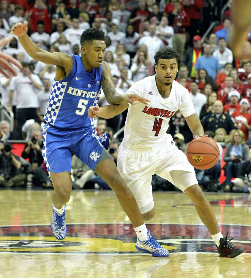 Louisville's Quentin Snider, right, attempts to drive past Kentucky's Malik Monk on Wednesday. Photo: The Associated Press    / FR43398 AP