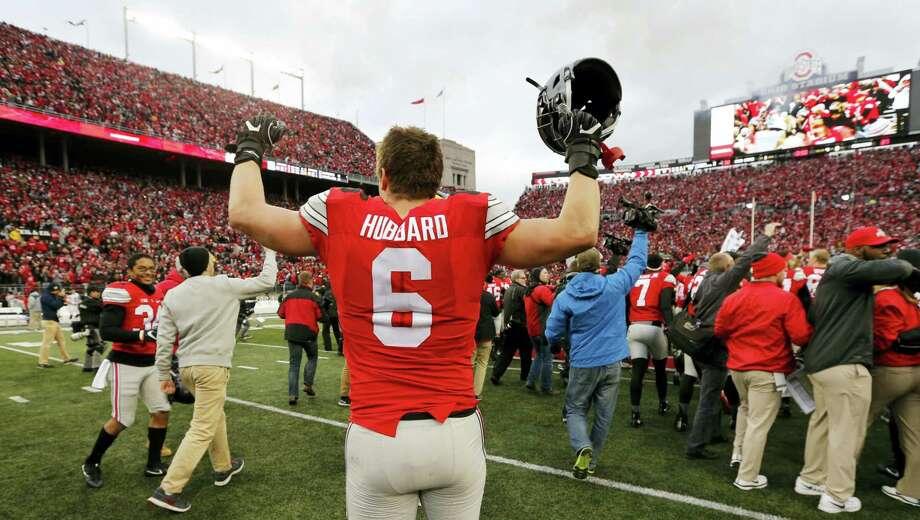 Ohio State defensive end Sam Hubbard celebrates their win over Michigan. Photo: Jay LaPrete — The Associated Press   / FR52593 AP