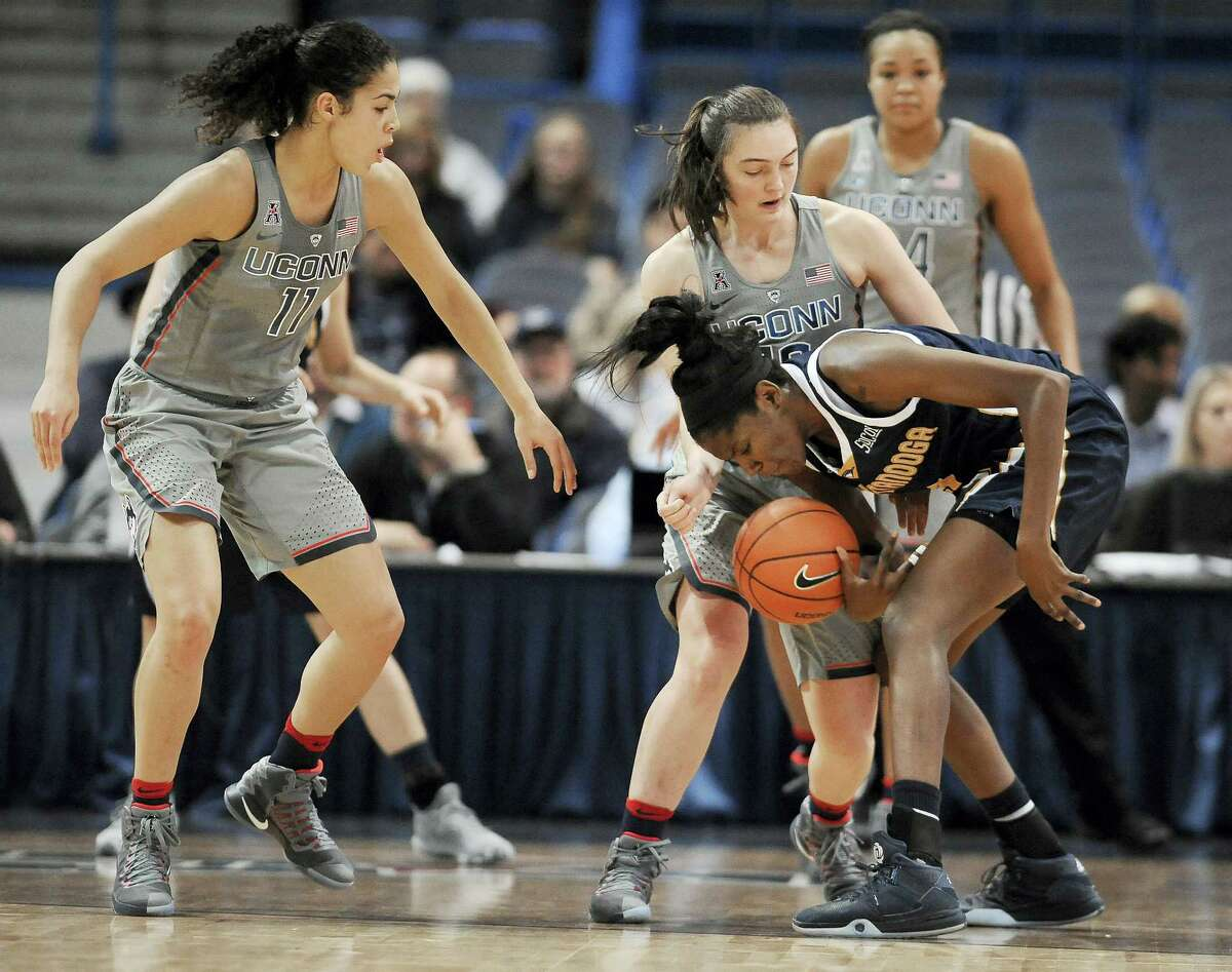 UConn's Molly Bent, center, pressures Chattanooga's Jasmine Joyner, right, as Connecticut's Kia Nurse, left, defends in the first half Tuesday in Hartford.