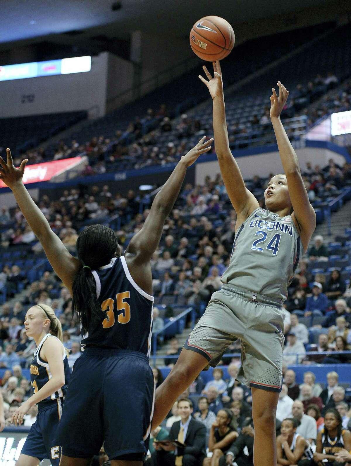 UConn's Napheesa Collier, right, shoots over Chattanooga's Aryanna Gilbert.