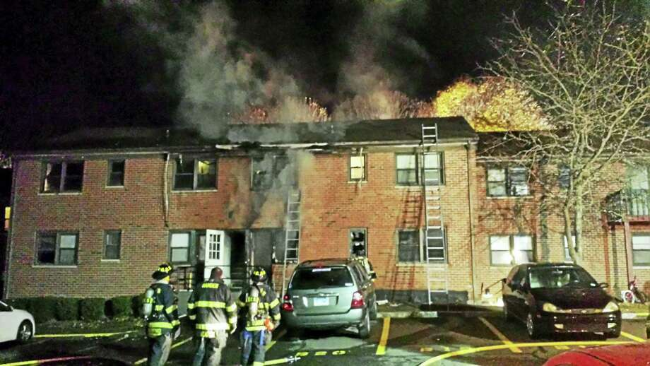 A fire broke out late Monday at 649 Mix Ave. in Hamden. No one was hurt but at least four apartments were damaged and several families were displaced. Photo: Anna Bisaro — New Haven Register