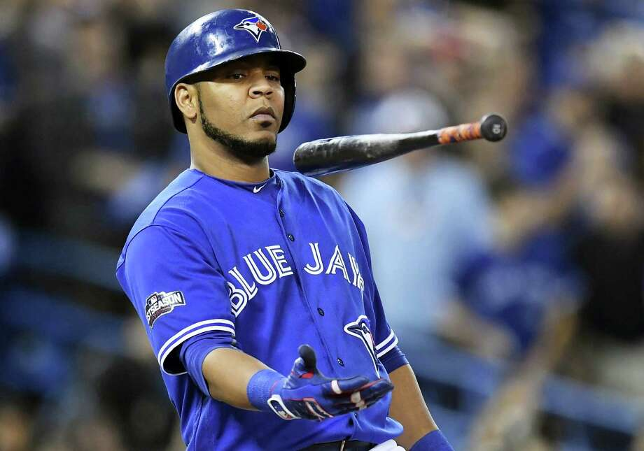 FILE - In this Wednesday, Oct. 19, 2016 file photo, Toronto Blue Jays' Edwin Encarnacion flips his bat after a foul ball against the Cleveland Indians during fourth inning in Game 5 of baseball's American League Championship Series in Toronto. A person familiar with the negotiations says free agent slugger Edwin Encarnacion has reached agreement on a contract with the Cleveland Indians. The sides reached a deal on Thursday night, Dec. 22, 2016 pending a physical. Encarnacion hit 42 homers and drove in 127 runs last season. (Frank Gunn/The Canadian Press via AP, File) Photo: AP / CP