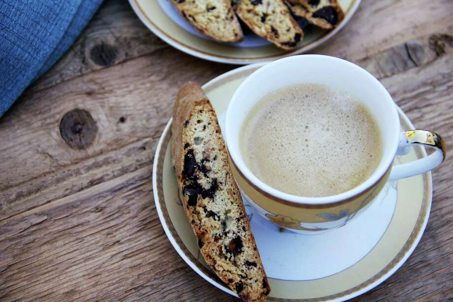 This recipe for biscotti, the firm, dry Italian cookie, is flavored with dark chocolate and rosemary because they are classic winter flavors. Photo: Melissa D'Arabian — The Associated Press   / Melissa d'Arabian