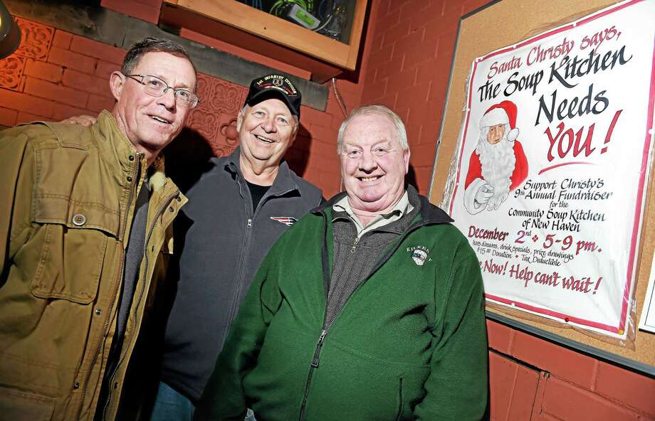From left, David O'Sullivan, executive director of the Community Soup Kitchen; Community Soup Kitchen volunteer Vic Binkoski; and Christy Mulhall at Christy's Irish Pub in New Haven to promote the Santa Christy's 2015 fundraiser for the Community Soup Kitchen of New Haven. Photo: Arnold Gold — New Haven Register FILE PHOTO