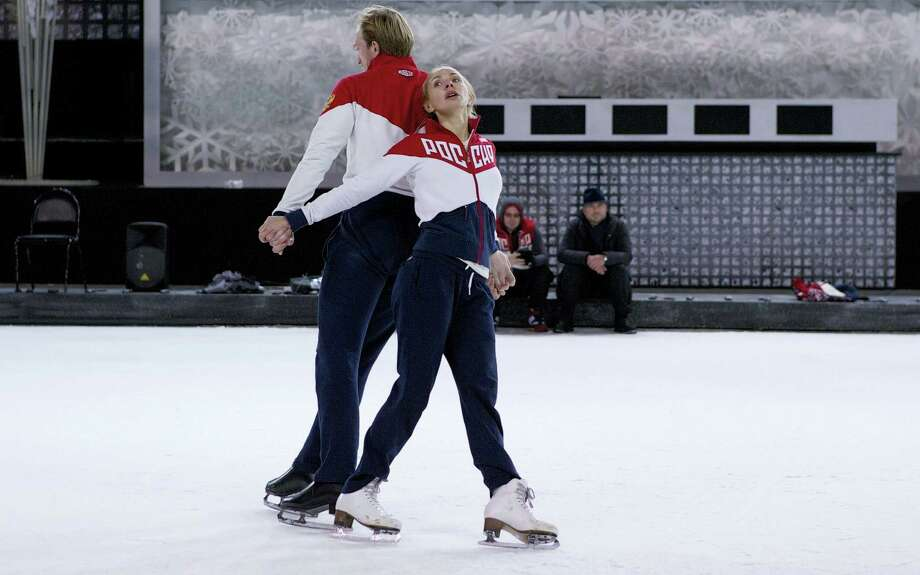Former Russian figure skater Tatiana Navka, right, and her on-ice partner Andrei Burkovsky skate during a training session in Moscow. Navka and Burkovsky caused controversy by dressing up in concentration camp uniforms for a routine on a popular television show. Later they've said it was their way of paying homage to Holocaust victims. Photo: The Associated Press File Photo   / Copyright 2016 The Associated Press. All rights reserved.