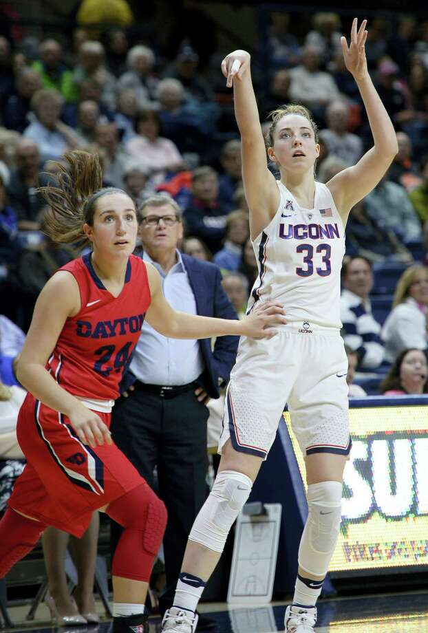UConn's Katie Lou Samuelson, right, watches her three-point basket go in against Dayton. Photo: Jessica Hill — The Associated Press   / AP2016