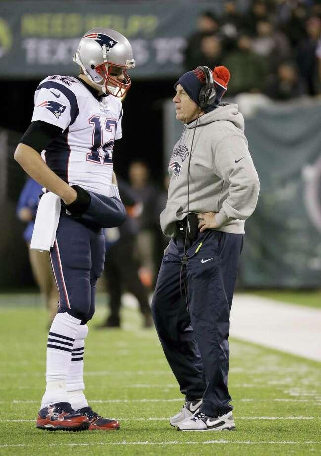 New England Patriots quarterback Tom Brady (12) talks with head coach Bill Belichick. Photo: Julio Cortez — The Associated Press   / Copyright 2016 The Associated Press. All rights reserved.