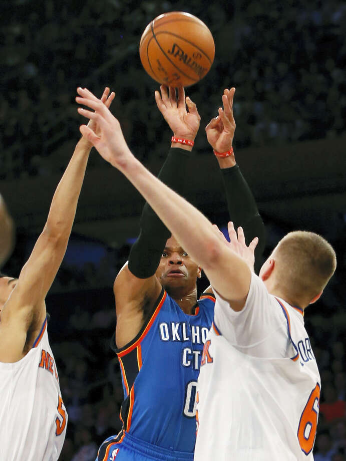 Thunder guard Russell Westbrook shoots between a pair of Knicks defenders on Monday. Photo: The Associated Press   / Copyright 2016 The Associated Press. All rights reserved.