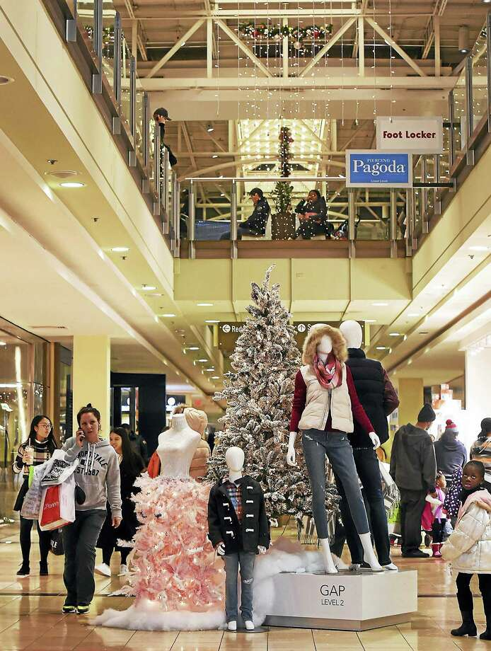Shoppers stroll through the Connecticut Post Mall in Milford on Black Friday, Nov. 25. Photo: Catherine Avalone — New Haven Register / New Haven RegisterThe Middletown Press