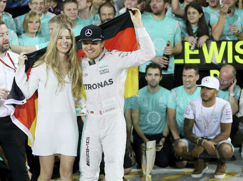 Mercedes driver Nico Rosberg of Germany, center right, is sprayed with champagne by his team after becoming 2016 F1 world champion. Photo: Kamran Jebreili — The Associated Press    / Copyright 2016 The Associated Press. All rights reserved.