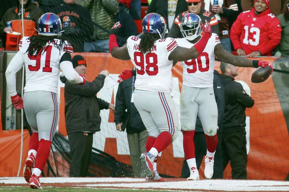 Giants defensive end Jason Pierre-Paul (90) celebrates his interception and touchdown with teammates on Sunday. Photo: Ron Schwane — The Associated Press    / AP