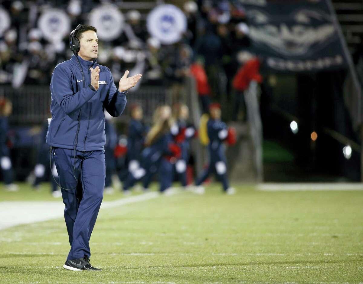 UConn head coach Bob Diaco encourages his team during Saturday's game against Tulane.