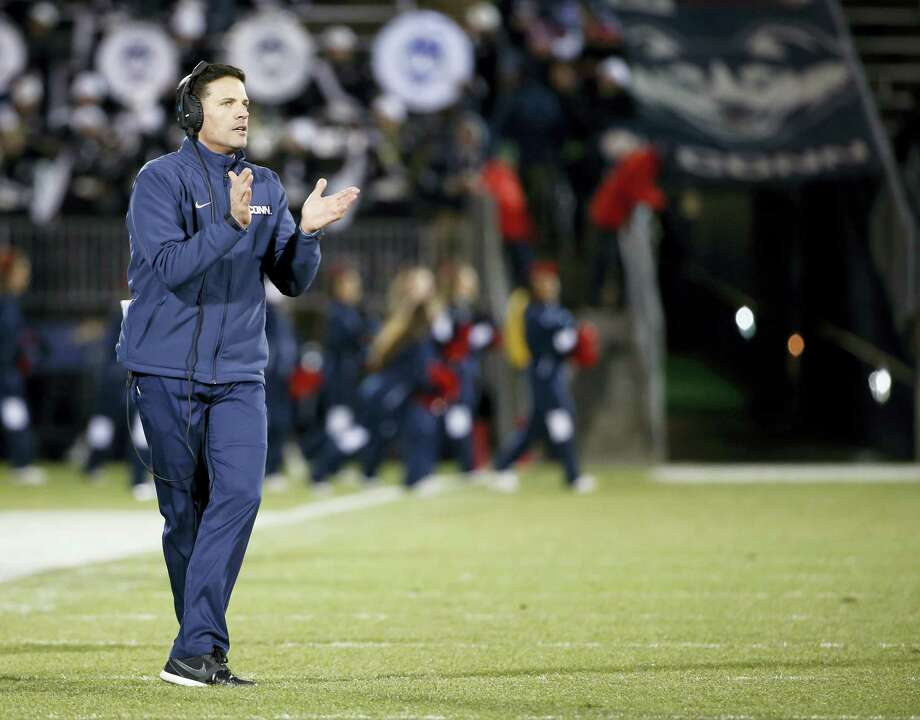 UConn head coach Bob Diaco encourages his team during Saturday's game against Tulane. Photo: Mary Schwalm — The Associated Press   / FR158029 AP