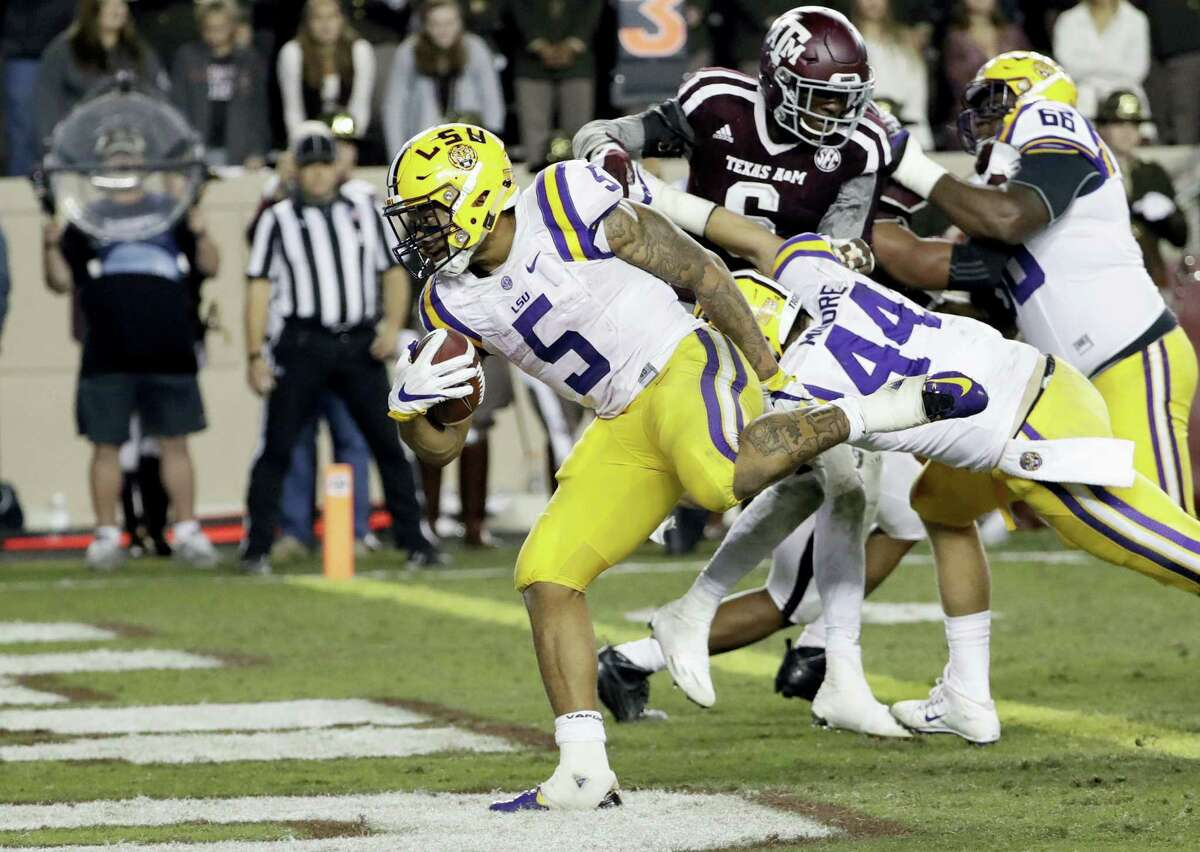 LSU running back Derrius Guice (5) rushes for a touchdown against Texas A&M Saturday.