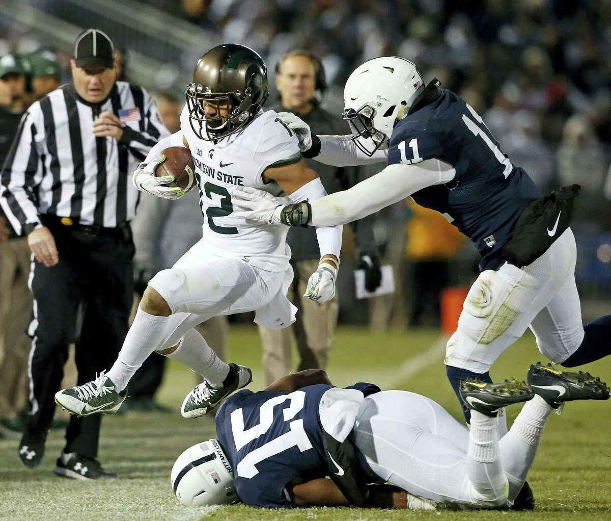 Penn State's Brandon Bell, right, pushes Michigan State's R.J. Shelton out of bounds during Saturday's game.