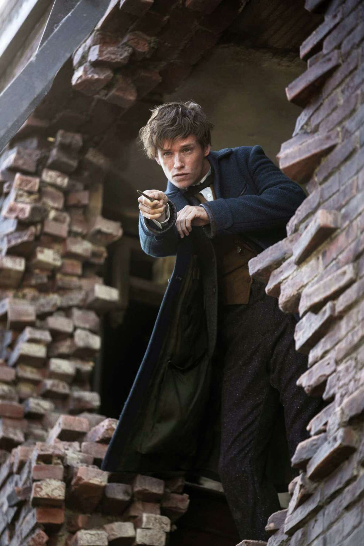 "This image released by Warner Bros. Entertainment shows Eddie Redmayne in a scene from, ""Fantastic Beasts and Where to Find Them."""